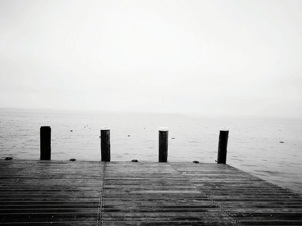 Sea Water Tranquility Horizon Over Water Tranquil Scene Nature Scenics No People Beauty In Nature Outdoors Landscape Day Beach Sky Sad & Lonely Tristesse Adapted To The City Looking To The Other Side Light And Shadow Black And White Monochrome Grey Grey Sky Greyscale Grey Sea Welcome To Black Long Goodbye