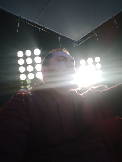 Low angle view of man against illuminated lights