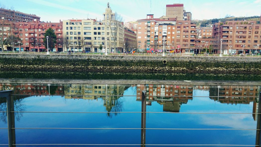Reflection Water Built Structure Architecture Building Exterior City SPAIN Bilbao Urban Skyline Cityscape River Riverside Deusto Architecture Skyscraper City Outdoors Cloud - Sky