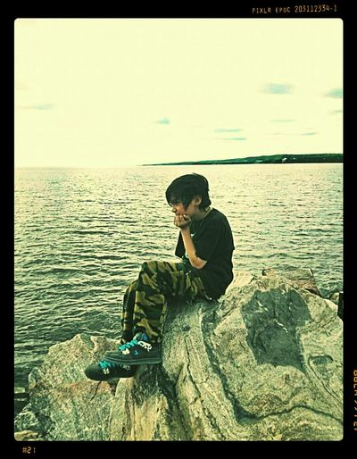 ...a boy and his thoughts... Showcase March Showcase: March 2016 A Boys Life A Boy At The Edge Of The World A Boy Lake View Lakeside Rocks And Water A Pensive Boy Connected With Nature Contemplating Portrait_shots Sony Xperia Beautiful World On The Edge Of The World Daydreaming Summer Memories... Beautiful Breeze The Breeze Vintage Look Simplicity Simple Things In Life The Simple Life