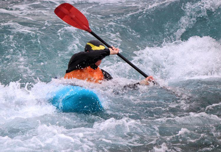 Man kayaking on river