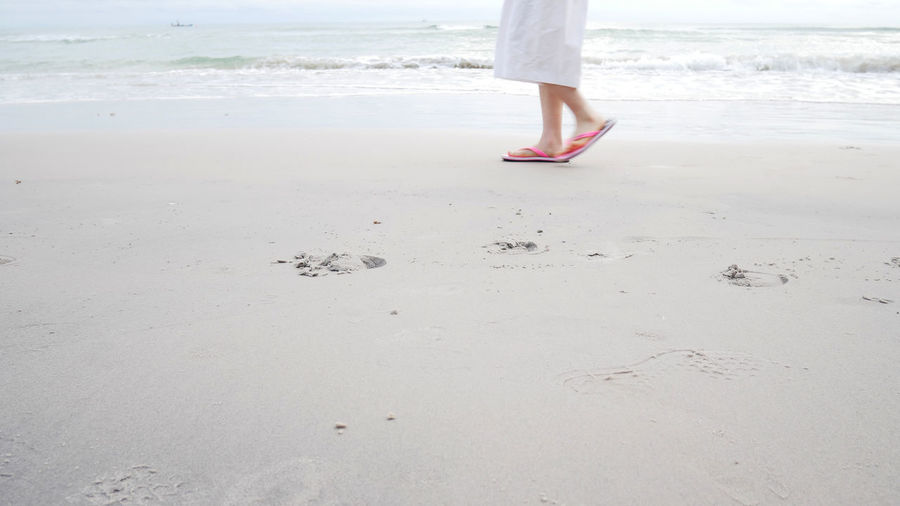Morning Walking Around Water Reflections Beach Body Part Day Human Body Part Human Foot Human Leg Land Leisure Activity Lifestyles Low Section Nature Ocean One Person Outdoors Real People Sand Sea Soft Focus Standing Walking Water Women