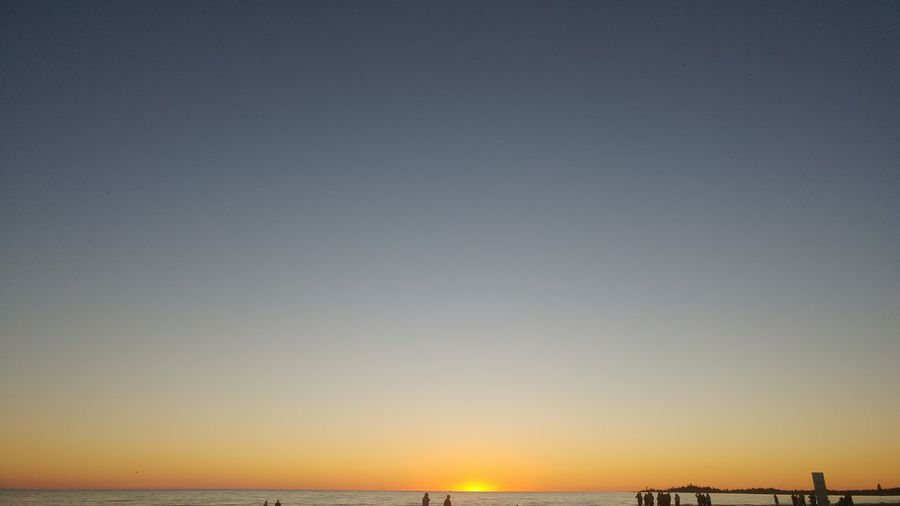 last minutes of summer sun Mostly Sky Layered Colors Sliver Of Beach Almost Nightfall Yellow Sky Beach People Silhouette Sunset Clear Sky Blue Sky