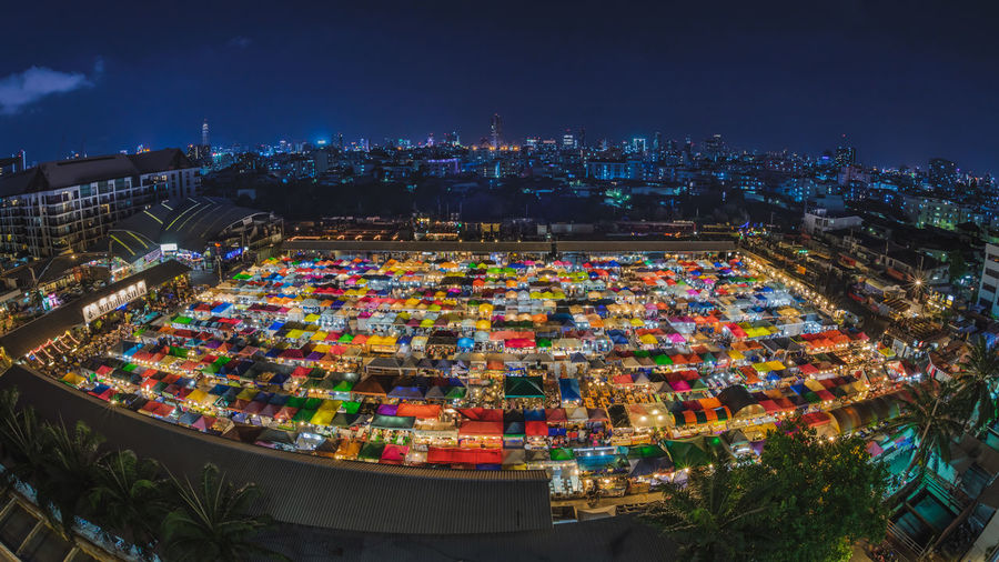 Aerial view of illuminated market and city at night