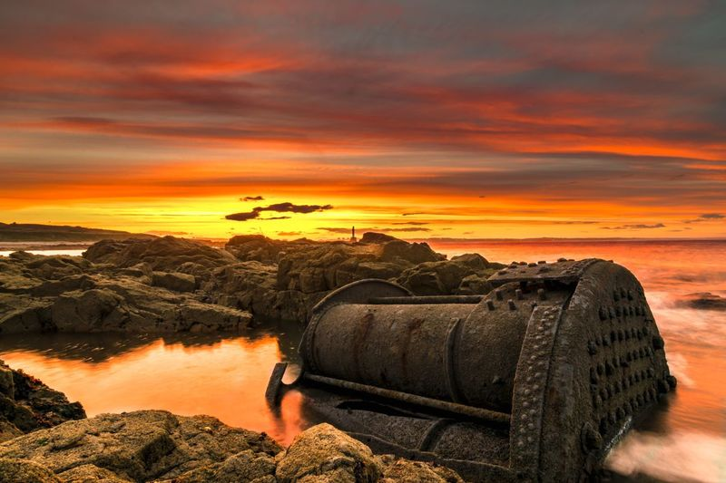 Wrecked boat on rocky shore