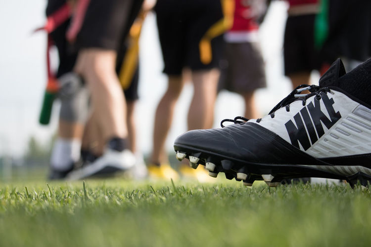 Grass Shoe Sunny American Football - Sport Cleats Day Flag Football Focus On Foreground Nike Outdoors Selective Focus Sports