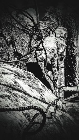 the rock wall Concrete Rubble Wall Peru Blackandwhite Stone Material Stone Close-up Cable Tangled