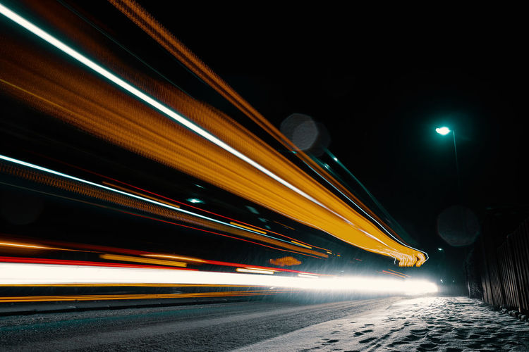 SMALL BLIZZARD Night Illuminated Street Transportation City Mode Of Transportation Road No People Land Vehicle Outdoors Light Winter Snow Traffic Speed Motion Light Trail Blurred Motion Long Exposure Architecture Built Structure Lighting Equipment on the move Sky