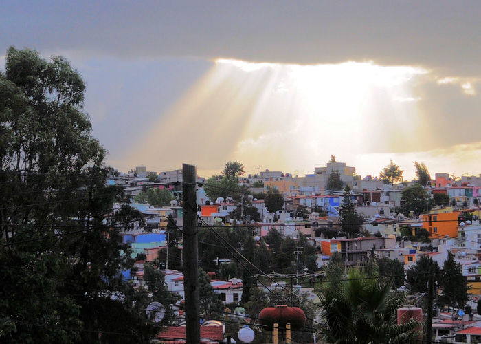 After the storm, the sun is breaking through the clouds Atizapan Mexico City Sky Clearing Up After The Storm Architecture Beauty In Nature Building Exterior Built Structure City Cityscape Day Nature No People Outdoors Sky Sun Breaking Through Clouds Sunbeams Sunlight Sunshine Tree
