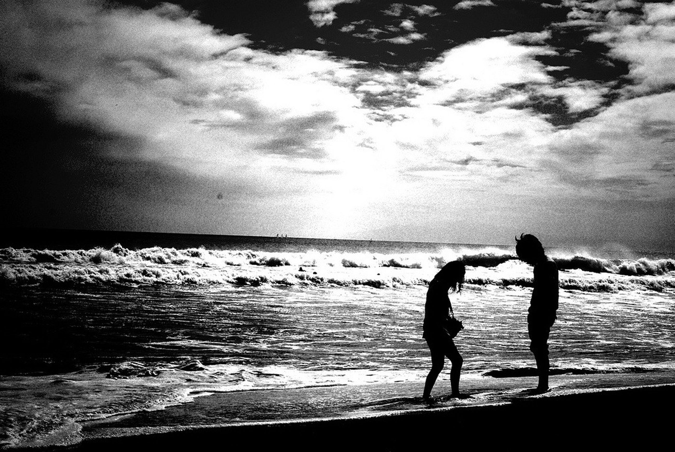 water, beach, sea, full length, leisure activity, lifestyles, shore, horizon over water, sky, childhood, boys, girls, silhouette, vacations, standing, togetherness, beauty in nature, nature