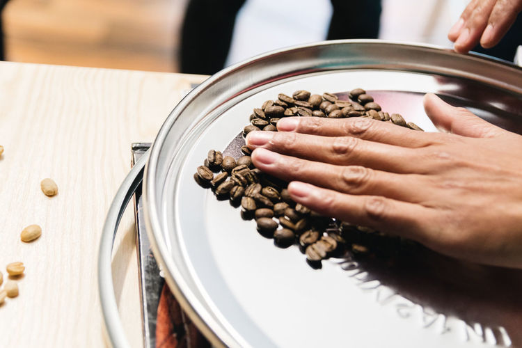 Coffee Beans Human Hand Hand Human Body Part Food And Drink Food One Person Indoors  Freshness Unrecognizable Person Preparation  Table High Angle View Real People Holding Close-up Selective Focus Preparing Food Wellbeing Healthy Eating Chef Finger