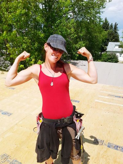 Working Working Building Houses Framer Caepentry Modern Workplace Culture Young Women Tree Portrait Standing Human Arm Sun Hat Arms Raised Casual Clothing Self Portrait Photography Posing