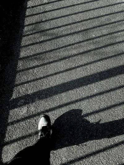 One Person Real People Lifestyles Low Section Human Leg Adult Environment Backgrounds Playing With Light And Shadow Silhouette Shadowsandlight Shadow Photography The Way Forward Railingshadows Railings Foot Walking Around Walking Boots Walking Around Taking Pictures