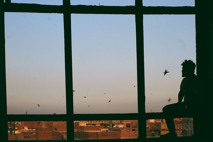 SUJAN SINGH HAVELI. Window Windows Cloud - Sky Bird Birds Sunset Sunlight Shadows & Lights Against The Light Architecture Old Architecture Preserved Aesthetics Red Traveling People Shades Shades Of Red Interesting Rawalpindi Old-fashioned Sky Close-up Gate Shattered Glass City Gate Fall Frame Fence Iron The Architect - 2018 EyeEm Awards The Photojournalist - 2018 EyeEm Awards The Creative - 2018 EyeEm Awards The Traveler - 2018 EyeEm Awards The Street Photographer - 2018 EyeEm Awards The Fashion Photographer - 2018 EyeEm Awards