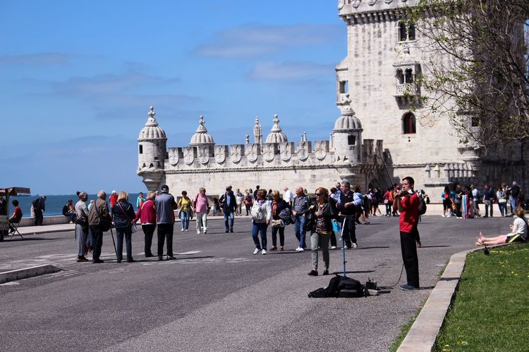 Tourists in front of historic building