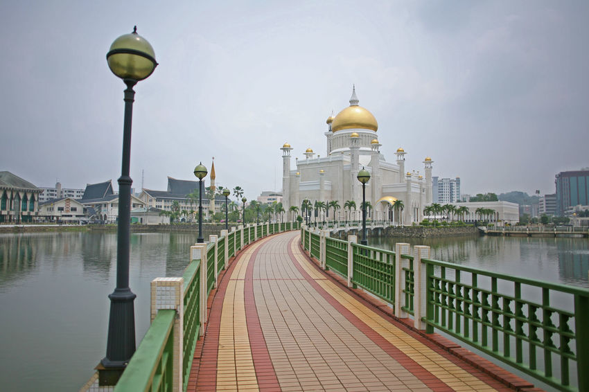 The pathway leading to the mesmerizsing Omar Ali Saifuddien Mosque in central Brunei, Borneo Brunei Brunei Darussalam Omar Ali Saifuddien Mosque Architecture Building Exterior Built Structure City Dome Outdoors Railing Travel Destinations Water