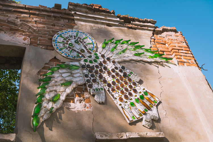 Angel of bottles on a broken wall Brick Wall Glass Art Glass Objects  Russia Wall Wall Art Wallart Abandoned Angel Angel Wings Art Art Object Bottles Brick Destroyed Glass Informal Kolomna Plaster Russian Street Art Unofficial