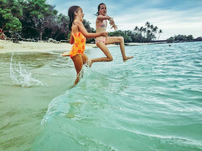 Done That. Two People Fun Water Full Length Leisure Activity Real People Happiness Vacations Enjoyment Young Women Young Adult Togetherness Smiling Outdoors Lifestyles Sea Nature Jumping Day Tree