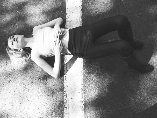 Women Shadow Sunlight Street Street Marking Road Road Marking The Week On EyeEm EyeEmNewHere Mix Yourself A Good Time Casual Clothing Beautiful Woman Fashion Model Lifestyle Female Portrait Female Model Fashion Fashion&love&beauty Blonde Woman Portrait Rubber Boots Sitting On The Street Black And White Portrait Laying On The Ground Blond Hair Be. Ready. Black And White Friday Stories From The City Inner Power