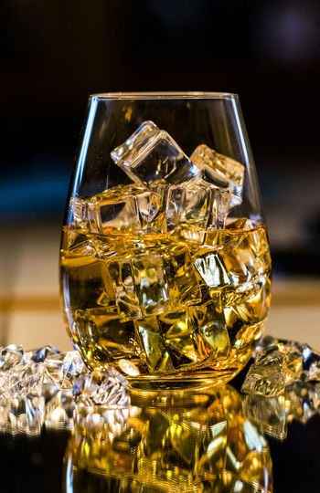 Close-Up Of Ice Cubes In Whiskey Glass