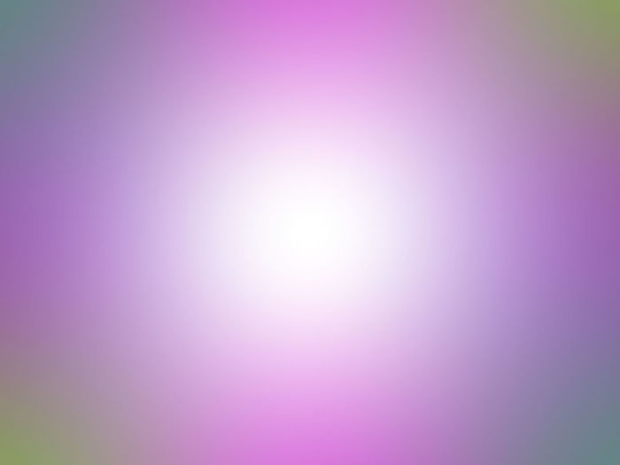 Defocused image of pink bright sun