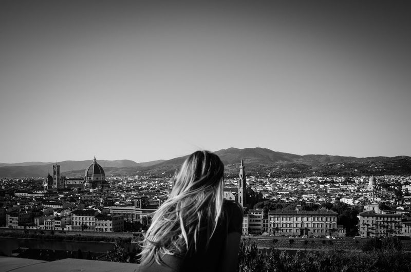 loneliness Solitude Blackandwhite Loneliness Selfportrait Florence Firenze Italy Black And White EyeEm Best Shots Young Women Women Portrait Long Hair Blond Hair Sky Architecture Cityscape Urban Scene Downtown