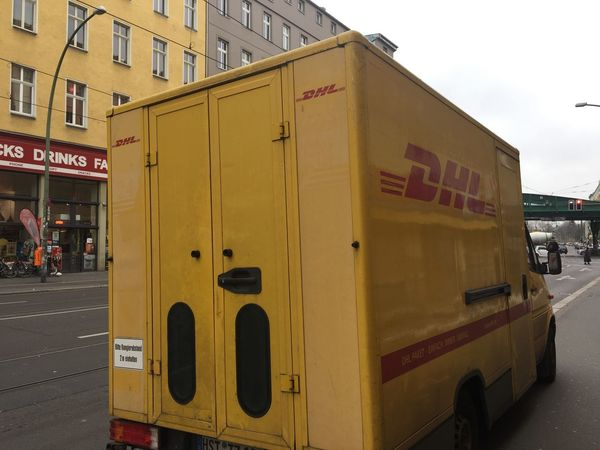 Berlin, Germany - December 1, 2017: DHL delivery van. Dhl is global market leader in logistics industry. It commits its expertise in international parcel, express, air and ocean freight, road and rail DHL Express Delivery Van Transit Transport Transportation Delivering Delivery Truck Land Vehicle Shipping  Transportation Vehicle Yellow