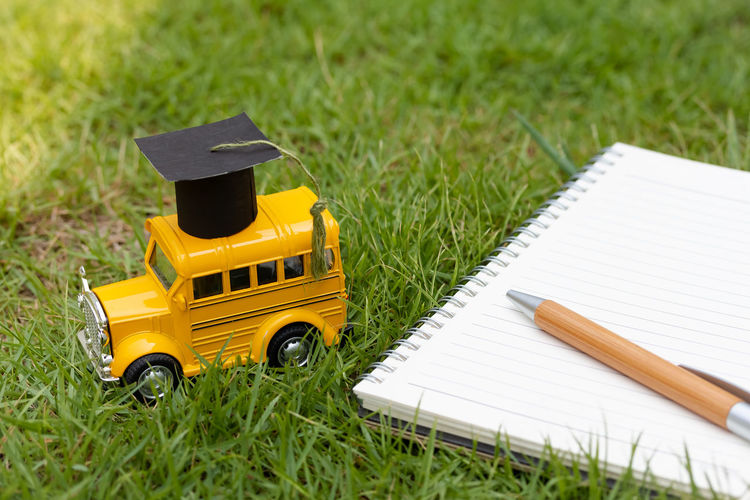 Grass School School Supplies School Bus Mortar Board White Pen Book Note Pad Notes Park Green Color Nature Outdoors Writing Write Story Diary Copy Space Mockup Studying Student Childhood Child Success Goal Knowledge Learning Learn Working Work Business Kid Toy Model Graduation Education University Cap College Degree Tassel Graduate Ceremony Achievement Celebration Diploma Academic Black Educate