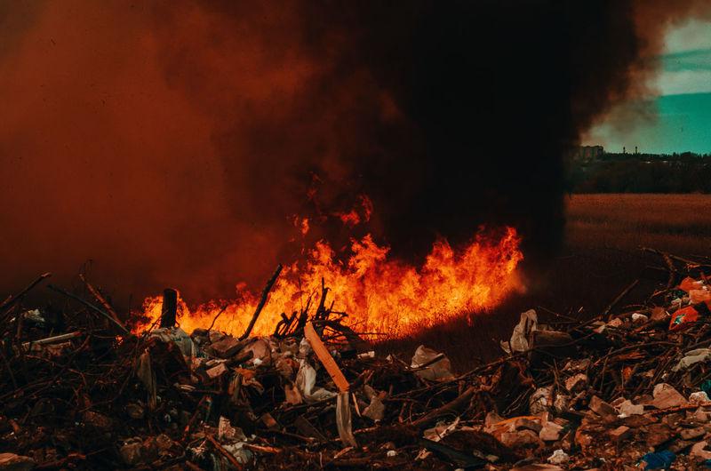 Bonfire on field at night