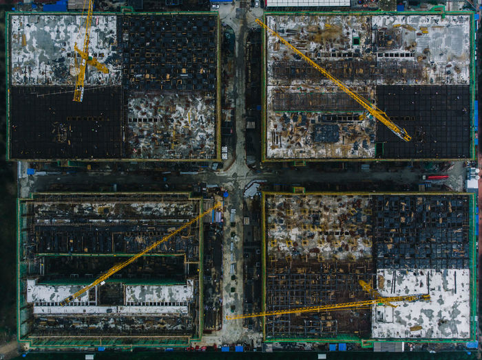 Aerial view of industrial buildings in city