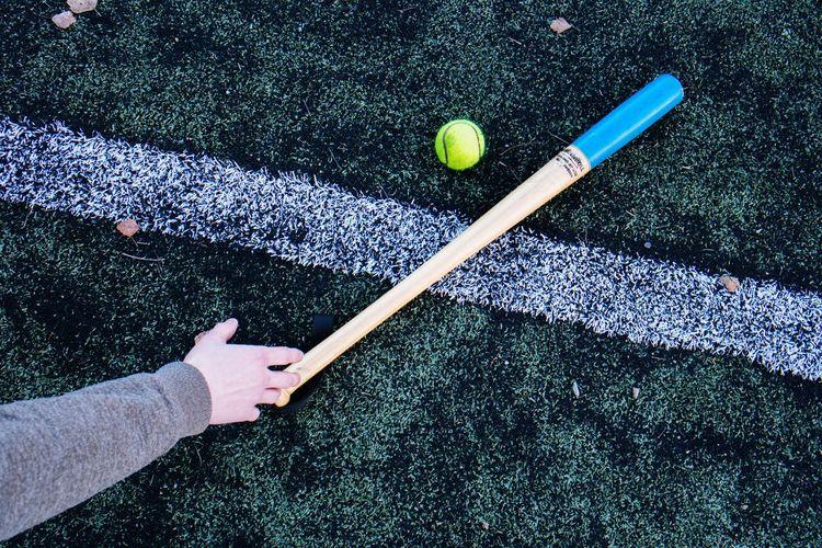 High angle view of hand holding ball