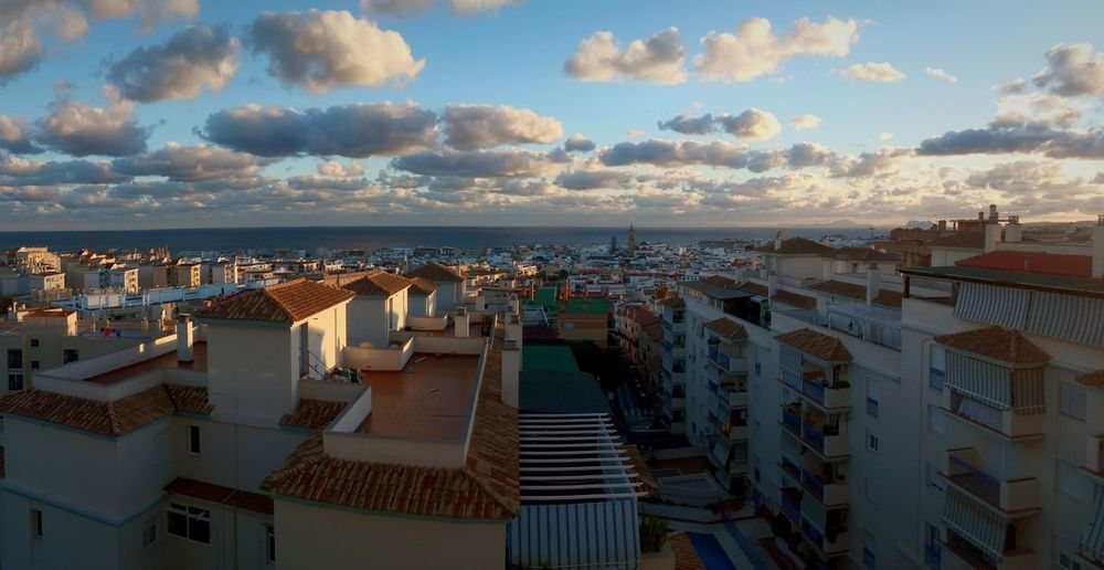 Estepona Southernspain Beautiful Malaga Sunset Clouds And Sky Sunlight Water Sea City Clouds Building Cityscape House Sea Aerial View Vacations Residential Building Urban Skyline City No People Outdoors Architecture Sky