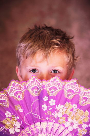 Child Behind Fan Adorable Boy Boys Childhood Cute Elementary Age Eyes Happiness Headshot Hiding Innocence Looking At Camera Peekaboo Person Pink Portrait Purple Real People