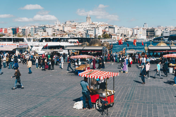 A crowded marketplace with a lone vendor in Istanbul. - IG: @LostBoyMemoirs (All photos taken on Sony A6300 and edited in Lightroom). Istanbul Turkey Turkish EyeEm Best Shots The Week on EyeEm Streetwise Photography Streetphotography Street Photography People People Watching people and places Travel Architecture Large Group Of People Lifestyles Street Market The Art Of Street Photography