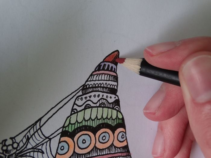 Cropped Image Of Person Drawing With Colored Pencil On Paper
