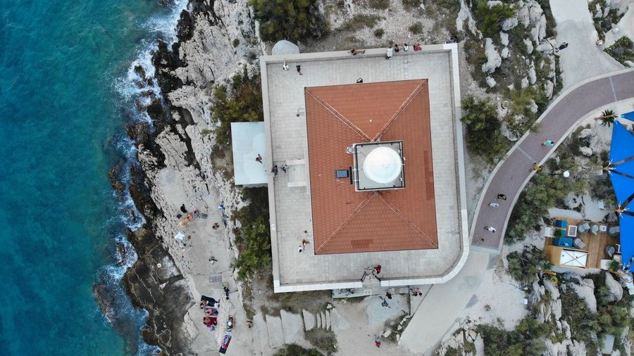 High Angle View Of Building By Sea During Winter