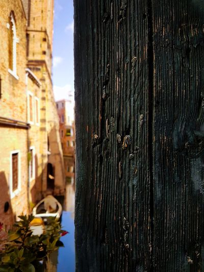Day Water No People Architecture Built Structure Outdoors Building Exterior Close-up Nature Sky Blinders Ca' Lavezzera Venezia Italy Vacations Travel Chiesa Di Santo Stefano Leaning Bell Tower Canals Parallel Lines Historical Buildings Architecture Backlight High Contrast Patterns & Textures