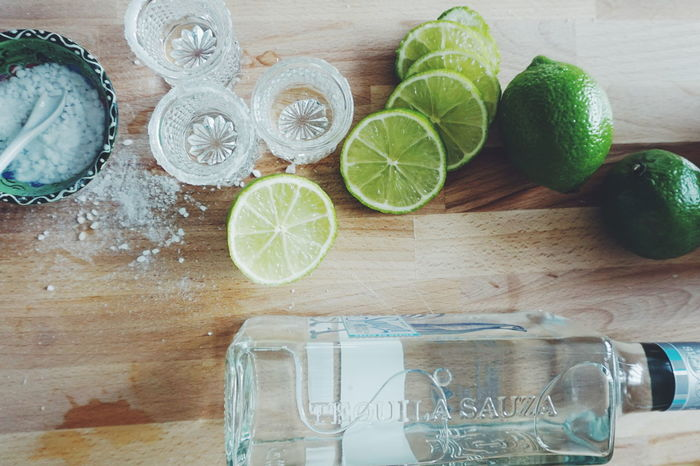 Tequila shots Alcohol Alcoholic Drink Cinco De Mayo Cincodemayo Citrus Fruit Close-up Cutting Board Day Directly Above Drink Food Freshness Fruit Healthy Eating Indoors  Lemon Lime Limes Mexican No People Salt Shot Shots SLICE Table