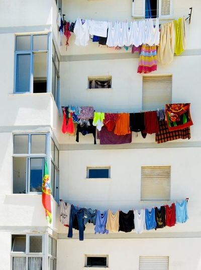 Apartment Building Apartment Living... Architecture Building Exterior Built Structure Clothes Clothesline Clothing Drying EyeEm Selects Flower Hanging Hanging Out To Dry Hanging Out Washing Laundry Multi Colored No People Outdoors Place Of Heart Portugal Variation Washing Washing Line Washing Lines Window
