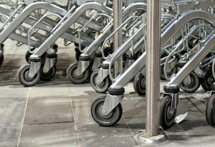 Close-up of shopping carts at mall