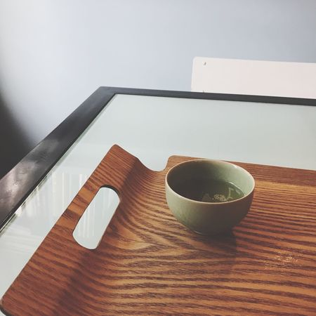A small cup of tea Table Indoors  No People Bowl Food And Drink Wood - Material Close-up Day Freshness Tea Bowl Zen Have A Break