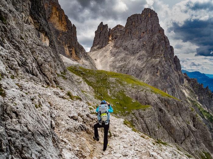 Rear view of man climbing on mountain
