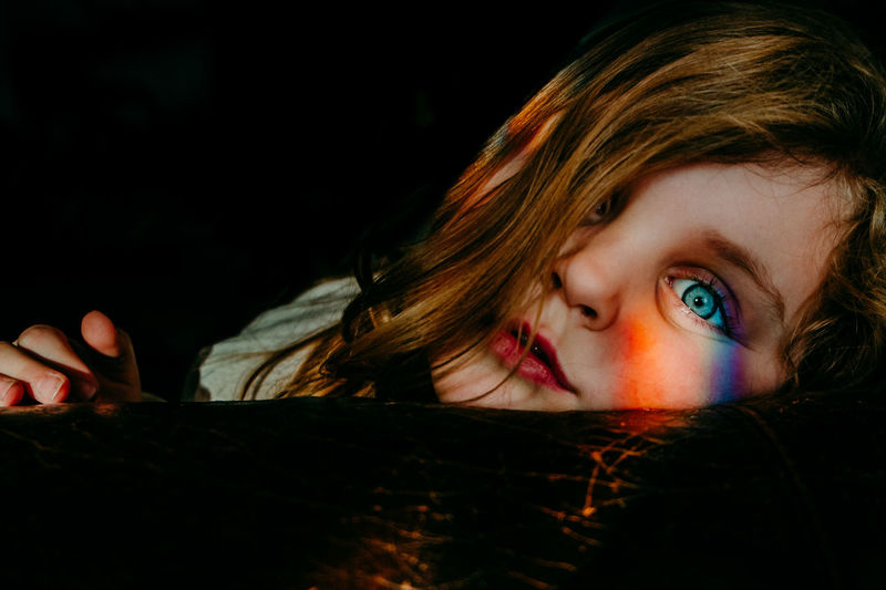 Rainbow Girl Portrait Headshot Childhood One Person Child Indoors  Looking Innocence Looking At Camera Black Background Close-up Girls Brown Hair Human Face Dark Rainbow Colors Light Blue Eyes Girl