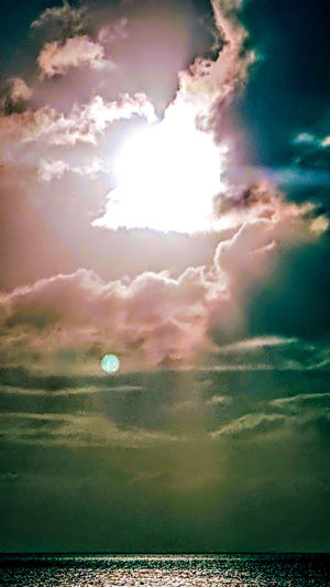 Lens Flare Sky Sunbeam Outdoors No People Cloud - Sky Nature Beauty In Nature Space Scenics Day Tranquil Scene Beauty Reflection Sunlight Dramatic Sky Idyllic Eyeem Market Horizon Over Water Silhouette Beauty In Nature Travel Destinations Clouds And Sky Tranquility Outside Photography