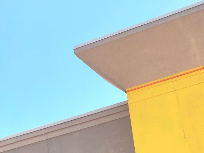 Bolt. Low Angle View Architecture Built Structure Building Exterior Day No People Clear Sky Blue Sky Yellow Minimalobsession Minimalism Minimal Neon Life Paint The Town Yellow