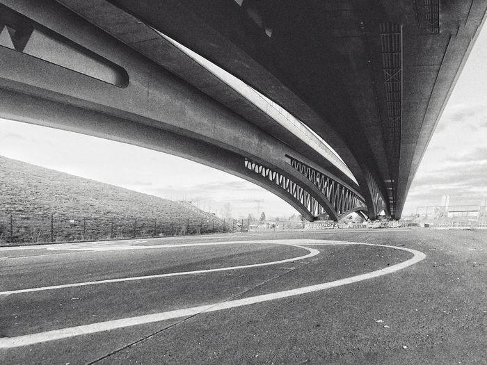 View of bridge over road in city