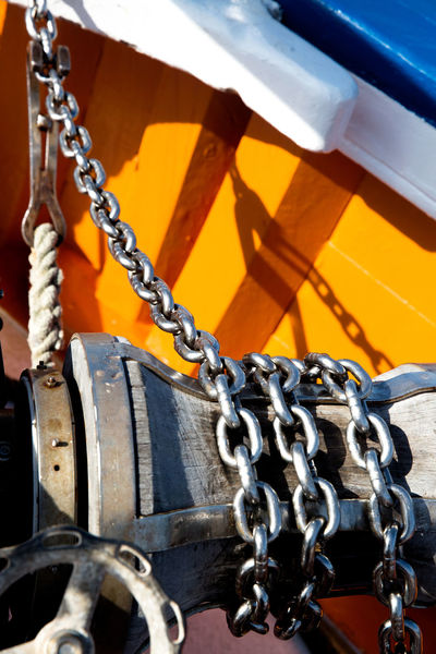 Chain Metal Transportation No People Close-up Strength Rope Mode Of Transportation Nautical Vessel Focus On Foreground Day Outdoors Sunlight Protection Safety Hanging Security Wheel Water Tire Sailboat Anchor Chain Windlass Maritime