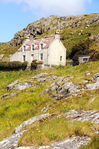 Castlebay Scotland Building Exterior Architecture Built Structure Building Plant Nature Day House Sky Land Landscape No People Mountain Environment Sunlight Outdoors Scenics - Nature Field Beauty In Nature