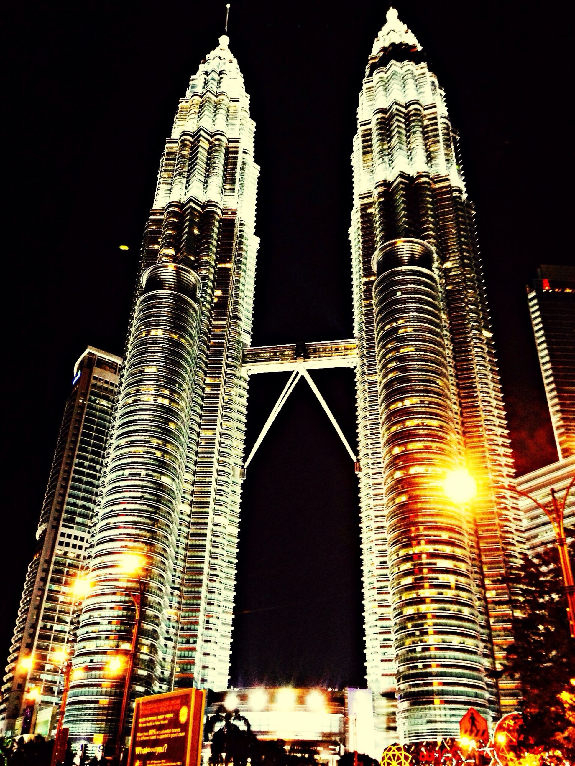 building exterior, architecture, built structure, illuminated, skyscraper, tall - high, city, tower, night, low angle view, famous place, international landmark, travel destinations, modern, capital cities, tourism, office building, travel, spire, clear sky