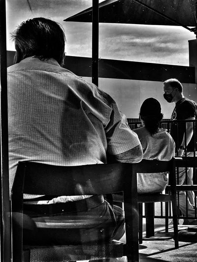 Rear view of people sitting in restaurant